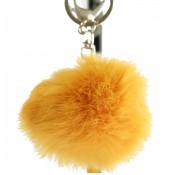 Porte-clés bijou de sac pompon jaune orangé en fourrure synthétique
