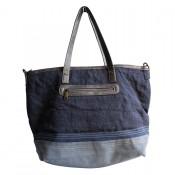 Sac à main bleu foncé et gris en tissu toilé, façon jean, avec motif étoile à paillettes, rivets et détails simili-cuir